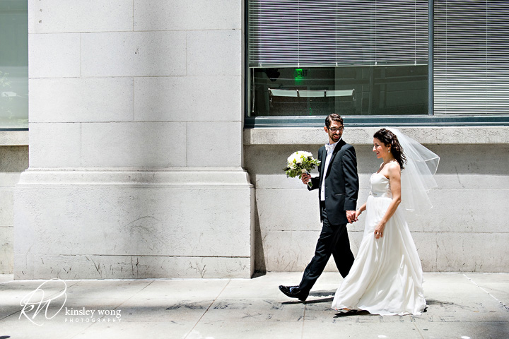 bride and groom walking to city club san francisco