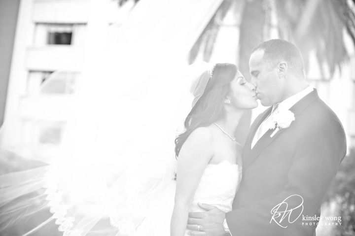 fairmont hotel wedding bride and groom share a kiss