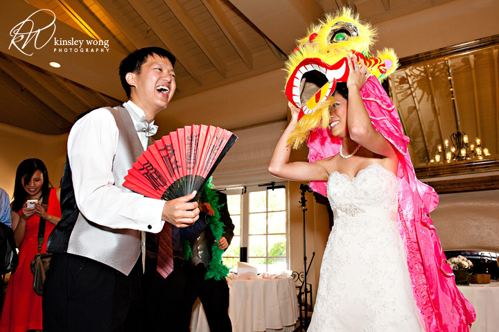 bride and grooms doing the lion dance