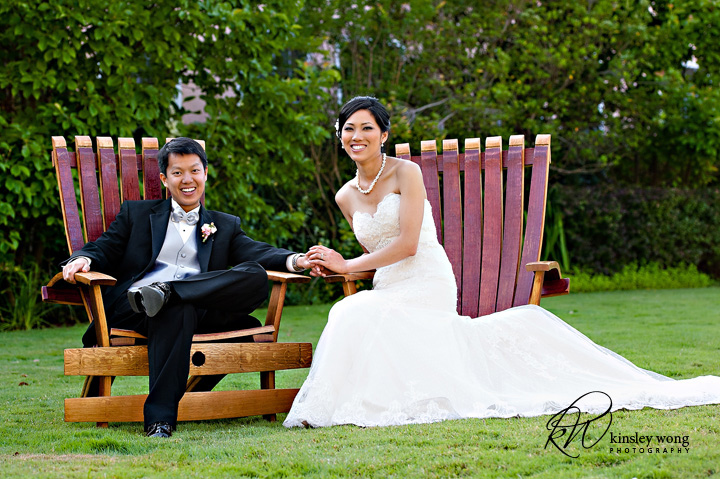 bride and groom just relaxing on some lounge chairs