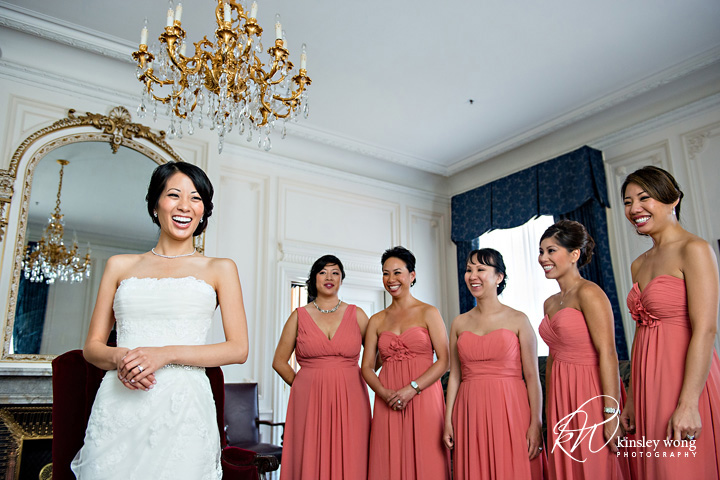 bride having a good laugh with the bridesmaid