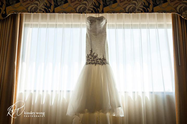 brides dress hanging on the window