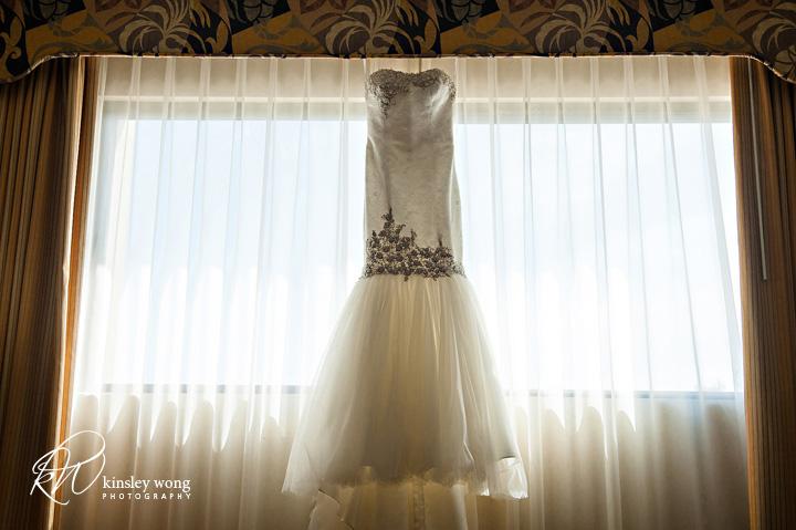 brides dress hanging on the window