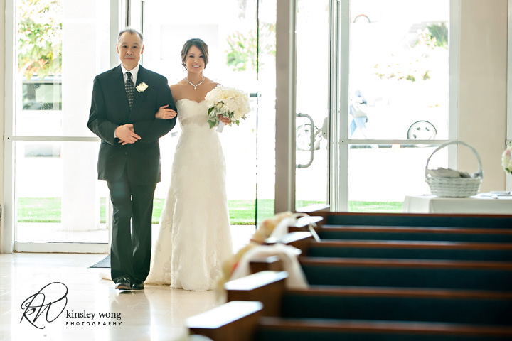 Bride walks down the isle with father at Riviera United Methodist Church in Redondo Beach