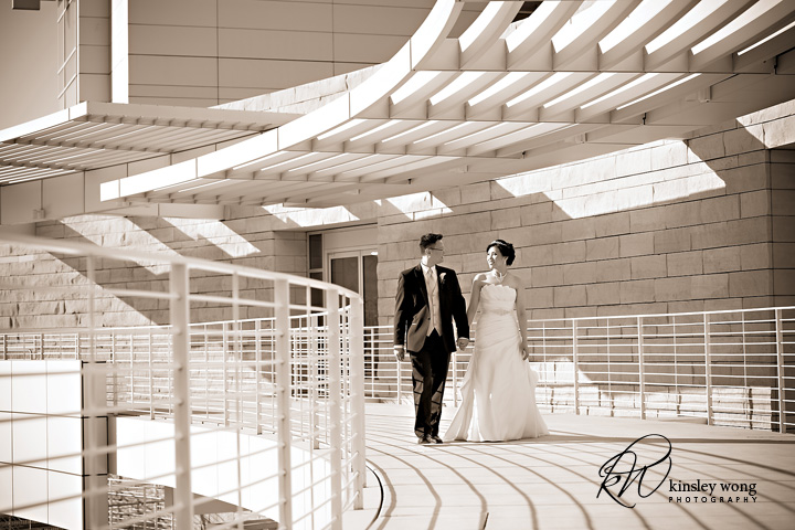 bride and groom walking to san jose city hall rotunda wedding
