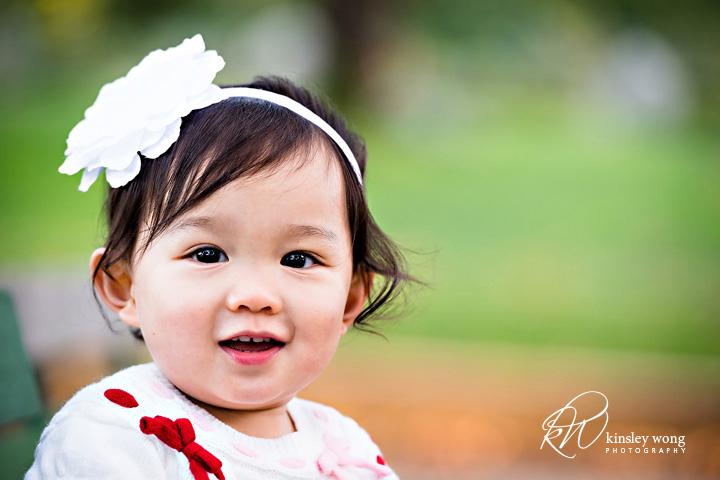 happy toddler taking photos