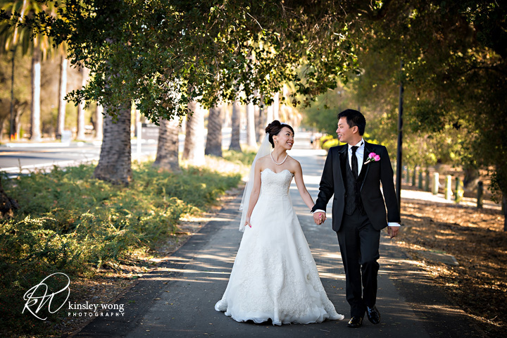 stanford bride and groom walking on palm drive